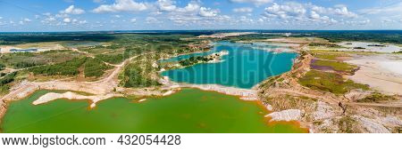 Colored Lakes On The Site Of The Abandoned Quarries Of Ilmenite Ore With Waste Rock Dumps Located Am
