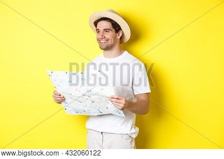 Travelling, Vacation And Tourism Concept. Handsome Guy Tourist Going Sightseeing, Holding Map And Sm