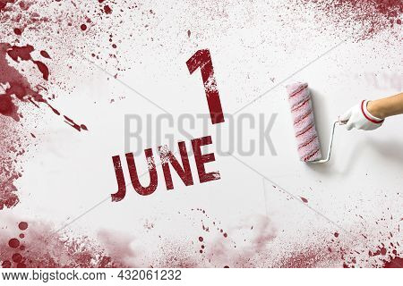 June 1st . Day 1 Of Month, Calendar Date. The Hand Holds A Roller With Red Paint And Writes A Calend