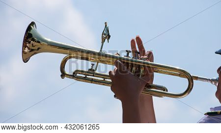 Playing A Brass Instrument. Military Band Performs At The Festival