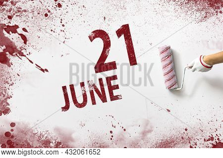 June 21st . Day 21 Of Month, Calendar Date. The Hand Holds A Roller With Red Paint And Writes A Cale