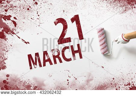 March 21st . Day 21 Of Month, Calendar Date. The Hand Holds A Roller With Red Paint And Writes A Cal