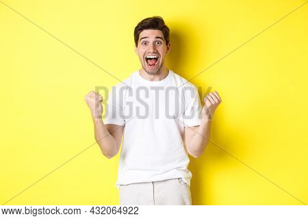 Excited And Lucky Man Winning, Clench Fists And Looking Happy, Triumphing And Celebrating, Standing