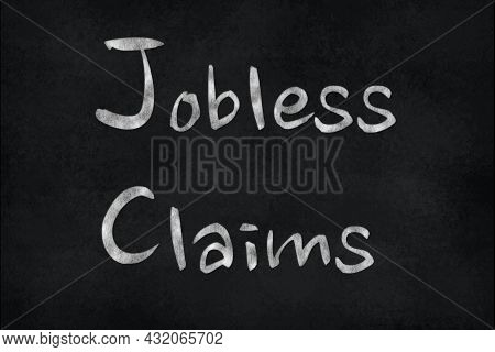 Chalk Writing On A Slate Board - Jobless Claims. Financial Market Concept