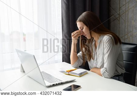Upset Stressed Worried Woman Sitting In Front Of Laptop, Holding Bridge Of The Nose, Female Office E
