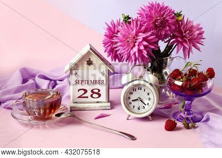 Calendar For September 28 : The Name Of The Month In English, Cubes With The Number 28, A Bouquet Of