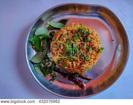 Stock Photo Of Delicious Popular South Indian Rice Dish Puliyogare, Its Also Called Pulihora Or Puli