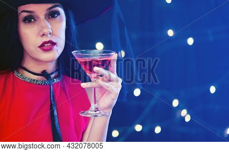 Caucasian Woman In Red Dress Holding Martini Glass With Pink Alcohol Liquor, Enjoy Halloween Party D