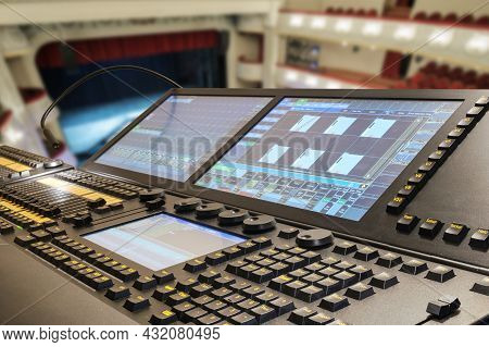 Professional Stage Lighting Control Console With Blurred Background Of A Theater Stage