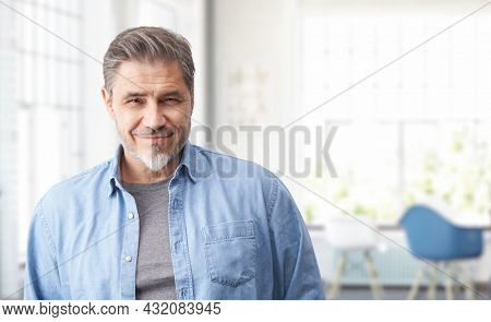 Portrait of mature age, middle age, mid adult casual man in 50s, happy confident smile. White background, copy space.