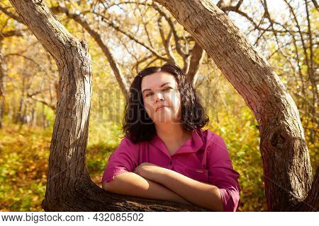 Kirov, Russia - September 27, 2020: Portrait Of Plump Chubby Senior Woman With Dark Curly Hair In Au