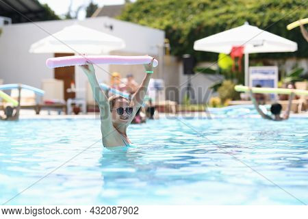 Women In Pool Do Water Aerobics As Rehabilitation Course At Spa Hotel