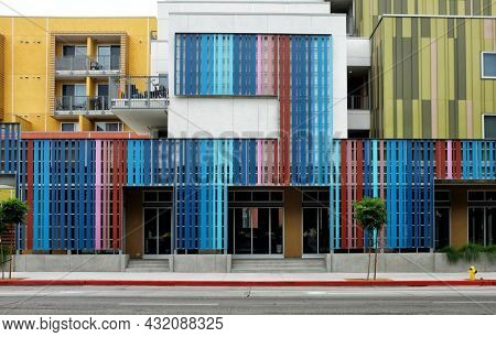 LOS ANGELES, CALIFORNIA - 18 AUG 2021:  Colorful exterior of new apartment buildings on Spring Street in the downtown area near Olvera Street.
