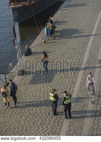 Prague, Czech Republic, March 26, 2021: The Police Officers Checking People During Covid Pandemic At