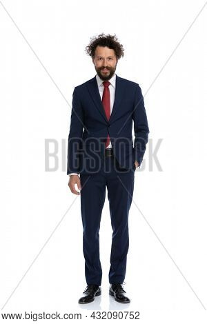 young businessman posing with one hand in pocket and the other loose against white background