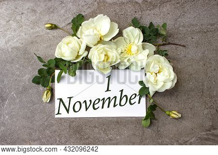 November 1st . Day 1 Of Month, Calendar Date. White Roses Border On Pastel Grey Background With Cale