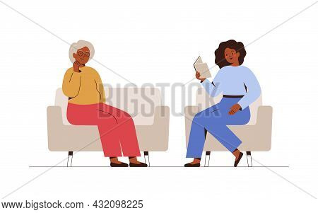 Young Female Caregiver Is Reading Book For Senior Woman. Volunteer Is Taking Care Of Elderly People.