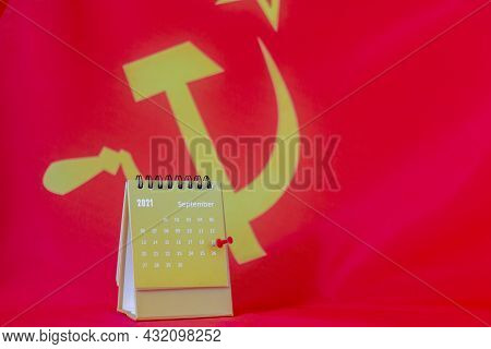 Calendar With Tear-off Sheets For September 2021 On The Background Of The Communist Party Flag.septe