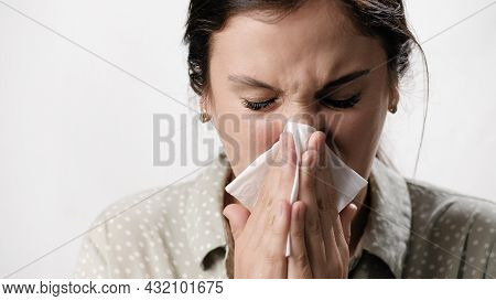 Nasal Congestion, Runny Nose. Woman With Cold And Flu Symptoms On White Background Blows Her Nose In