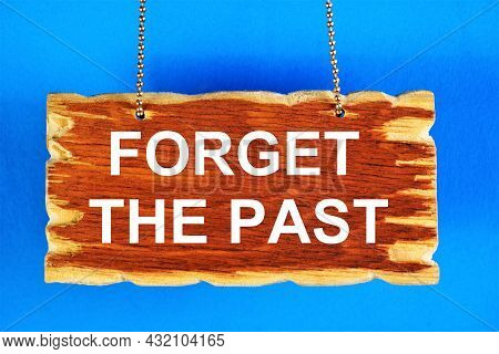 Forget The Past. The Inscription Is In A Vintage Plate. Sad Moments From Life Can Be Erased From Mem