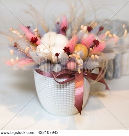 A Bouquet Of Dried Flowers Made Of Cotton Boxes, Carnations, Albizia, Cortaderia In A Beautiful Whit