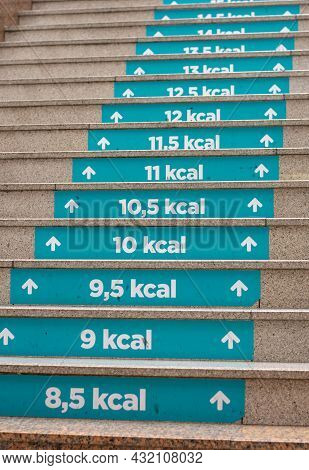 Calories Count At Staircase In Shopping Mall. Each Step Half Calories Burned. Exercises Awareness Co
