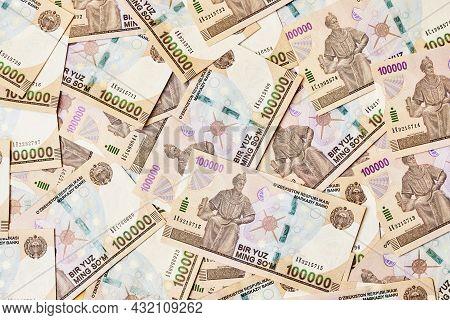 Pile Of Uzbek Sum Currency Money Bill. A Stack Of One Hundred Thousand Uzbek Sum. Uzbek Money. 10000
