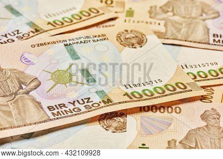 Macro Shot Of Uzbek Sum Banknote. Pile Of Uzbek Sums. Uzbek Currency Money Bill. A Stack Of One Hund