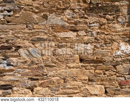 Natural Bright Yellow Limestone Wall Sunny Background With Shadows