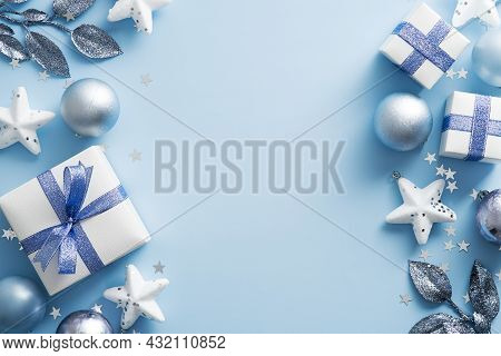 Modern Christmas Frame Border. Flat Lay Silver Balls, Gift Boxes, Stars Over Blue Background. Top Vi