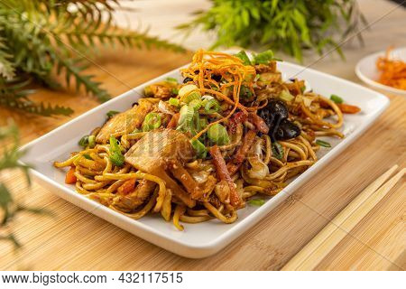Asian Style Food. Noodles Stir Fry With Ear Wood Mushrooms, Chicken Breast And Vegetables
