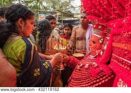 Kannur, India - December 2, 2019: Theyyam perform during temple festival in Kannur, Kerala, India. Theyyam is a popular ritual form of worship in Kerala, India