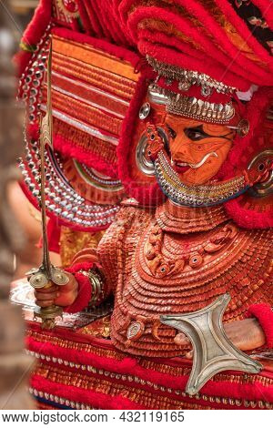 Kannur, India - December 3, 2019: Theyyam perform during temple festival in Kannur, Kerala, India. Theyyam is a popular ritual form of worship in Kerala, India