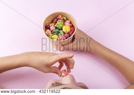 Adorable Little Child Boy Eating Colorful Rainbow Caramel Candy Popcorn On Pink Background. Cinema S