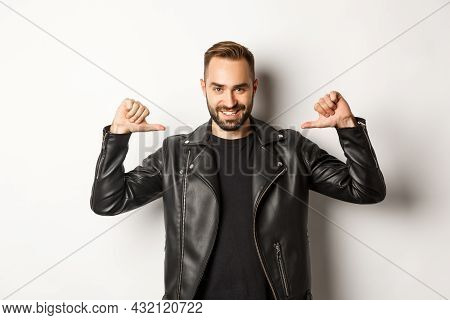 Confident Handsome Man Wearing Black Leather Jacket, Pointing At Himself And Smiling Self-assured, S