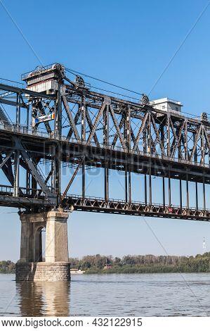 Vertical Photo Of Danube Bridge. This Is A Steel Truss Bridge Over The Danube River Connecting Bulga
