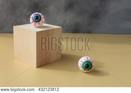 Halloween Creepy Bloody Eye Lies On The Podium. Place For Your Text.