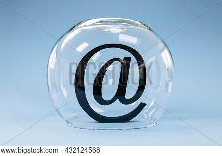 Email at symbol covered with a goldfish bowl concept for protecting e-mail from spam, virus, phishing and internet security