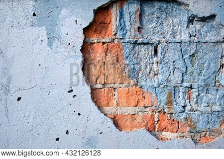 Ancient Weathered Brick Wall With Cracks And Destroyed Stucco Layer. Old Brick Wall. Vintage Backgro