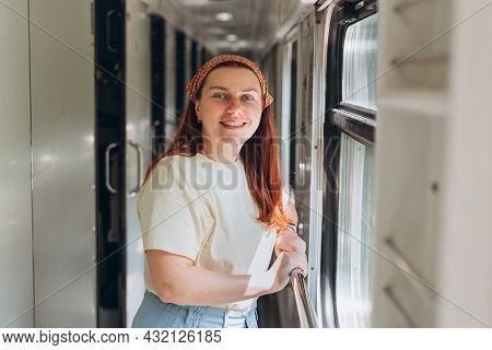 A Beautiful Hipster Woman Travelling On The Train In Europe. Tourist Travel Concept.