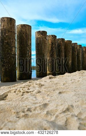 View Of A Wooden Breakwater On The Baltic Sea Coast