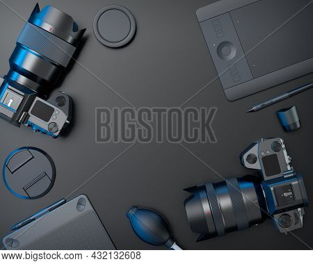 Top View Of Designer Workspace And Gear Like Optical Lens, Tablet, Digital Camera And Blower Bulb On