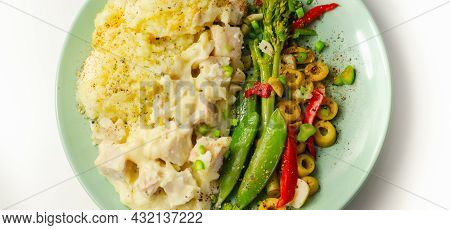 Tender Pieces Of Smoked Haddock And Pollock In A Creamy Cheese Sauce Sat Beneath Buttery Mash Served