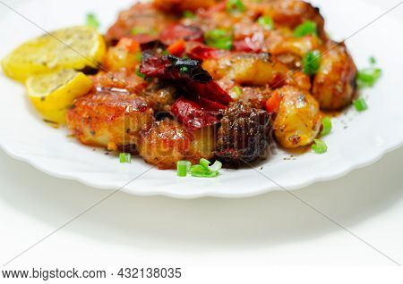 Tuscan Style Sauce With Gnocchi, Pork And Beef Meatballs And Grilled Red Peppers Garnished With Fres