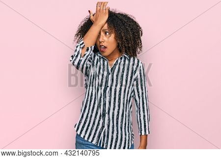 Young african american girl wearing casual clothes surprised with hand on head for mistake, remember error. forgot, bad memory concept.