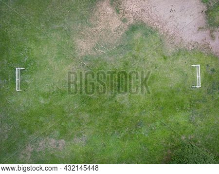Aerial View Field Nature Green Soccer Field Background, Top View Football Field From Above In The Co