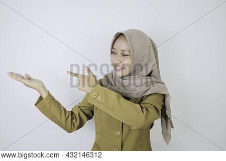 Smile Government Worker Women Pointing Beside. Pns Wearing Khaki Uniform.