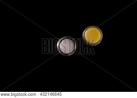 Cosmetic Yellow Balm From Other Manufacturers For Daily Skin Care On A Black Background. Skin Care P