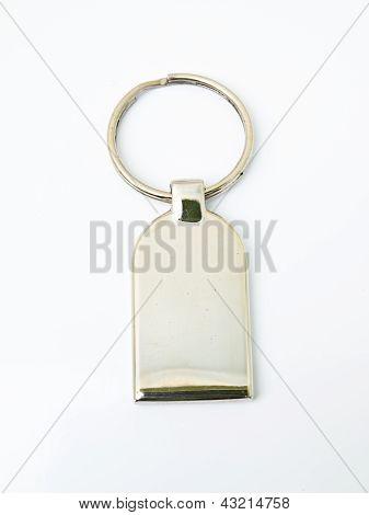 A Metalic Trinket Keychain Isolated On White Background