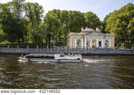 St. Petersburg, Russia - July 09, 2021: A Walking Boat With People Swims Along The River Fontanka On